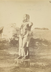 Front view of an ancient inscribed statue, perhaps a yaksha, Parkham, Mathura District
